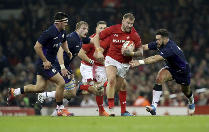 Wales' Ross Moriarty breaks through during the rugby union international match against Scotland at The Principality Stadium, Cardiff, Wales, Saturday Nov. 3, 2018. (David Davies/PA via AP)