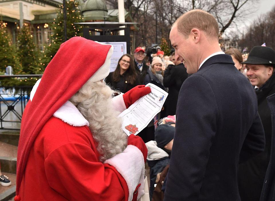 <p>Prince William gives Santa his son Prince George's Christmas list.</p>