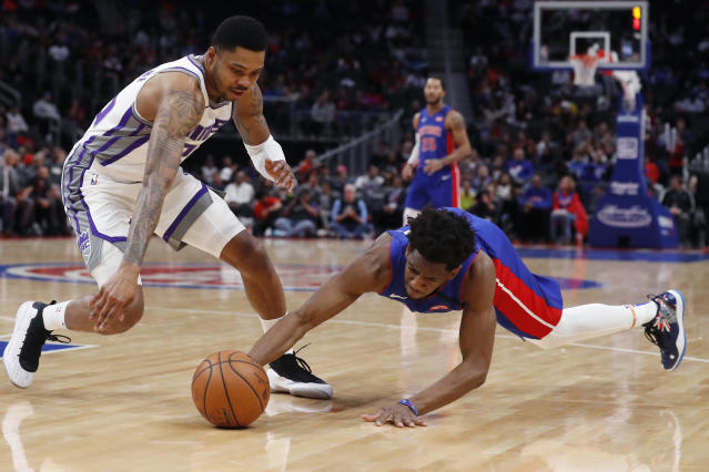 Detroit Pistons guard Langston Galloway, right, and guard Kent Bazemore chase the loose ball during the first half of an NBA basketball game, Wednesday, Jan. 22, 2020, in Detroit. (AP Photo/Carlos Osorio)