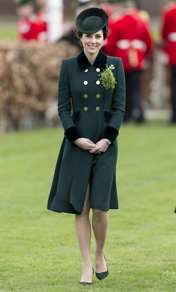 <p>For 2017 St. Patrick's Day, the Duchess of Cambridge wore a custom Catherine Walker coat in an emerald green with velvet trim and gold buttons. The royal also rocked a Lock & Co. fascinator and Gianvito Rossi suede heels, each matching the dark green shade of her jacket. She also pinned the late Queen Mother's gold shamrock brooch as well as actual sprigs of shamrock. (Photo: AP) </p>