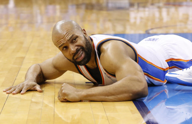 Oklahoma City Thunder guard Derek Fisher (6) lies on the court after a foul in the fourth quarter of Game 2 of the Western Conference semifinal NBA basketball playoff series against the Los Angeles Clippers in Oklahoma City, Wednesday, May 7, 2014. Oklahoma City won 112-101. (AP Photo/Sue Ogrocki)