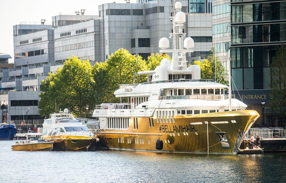 Ostentatious: The superyacht has been encased in gold vinyl. (SWNS)