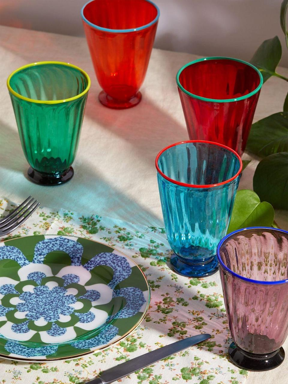 """<p>La Double J has teamed up with the Venetian glassmaker Salviati to create these playful and beautiful rainbow-coloured rigadin glasses. Each is handblown from transparent Murano glass – ideal for all of those maximalists. FC</p><p>£350 for four, <a href=""""https://www.matchesfashion.com/products/1277196?country=GBR&rffrid=sem.Google.n=g.cid=1755852453.aid=70456062124.k=.mty=.d=c.adp=.cr=341416798272.tid=aud-429262818371:pla-605776526866.pid=1277196000001.ppid=605776526866.lpm=1006681.adty=pla.prl=en&utm_content=1277196000001&utm_term=605776526866.[value].&gclid=CjwKCAjwj6SEBhAOEiwAvFRuKKgcjhObdtpH-8ydtsvn4Va7dhoctzYA-Oedj8Vcea69Heou3ekT-BoCNVwQAvD_BwE&gclsrc=aw.ds"""" rel=""""nofollow noopener"""" target=""""_blank"""" data-ylk=""""slk:Matchesfashion.com"""" class=""""link rapid-noclick-resp"""">Matchesfashion.com</a>.<br></p>"""