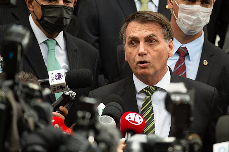 BRASILIA, BRAZIL - May 07: Jair Bolsonaro President of Brazil talks to the press after meeting with the Brazilian Supreme Court of Justice President Jose Antonio Dias Toffoli and businessmen during amidst on the coronavirus (COVID-19) pandemic at the Supreme Court on May 07, 2020 in Brasilia. Brazil has over 125,000 confirmed positive cases of Coronavirus and 8.536 deaths. (Photo by Andressa Anholete/Getty Images)