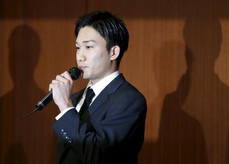 Japanese badminton player Kento Momota attends a news conference after reports on his gambling at an illegal casino in Tokyo, Japan, April 8, 2016. REUTERS/Issei Kato Picture Supplied by Action Images