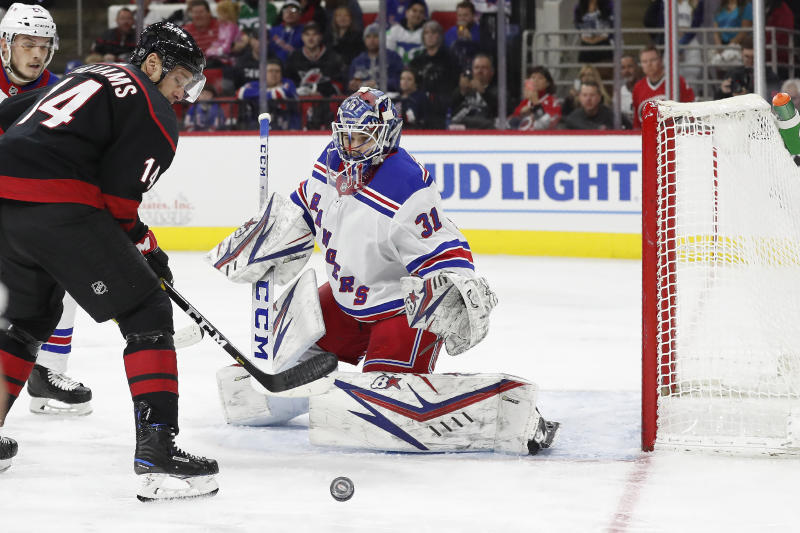 New York Rangers goaltender Igor Shesterkin (31), of Russia, defends the goal against Carolina Hurricanes right wing Justin Williams (14) during the second period of an NHL hockey game in Raleigh, N.C., Friday, Feb. 21, 2020. (AP Photo/Gerry Broome)