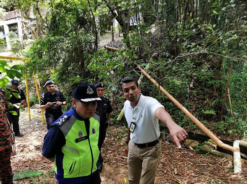 International relations IGP Secretariat Office ACP Nik Ezanee Mohd Faisal (right) shows Deputy Inspector-General of Police Datuk Mazlan Mansor around The Dusun resort August 11, 2019. — Picture courtesy of Royal Malaysian Police