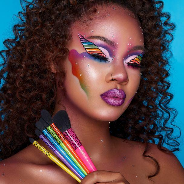 PHOTO: Model holding the 'Blend Bright 6-piece Brush Set' from the Morphe X Lisa Frank collection. (Morphe X Lisa Frank)