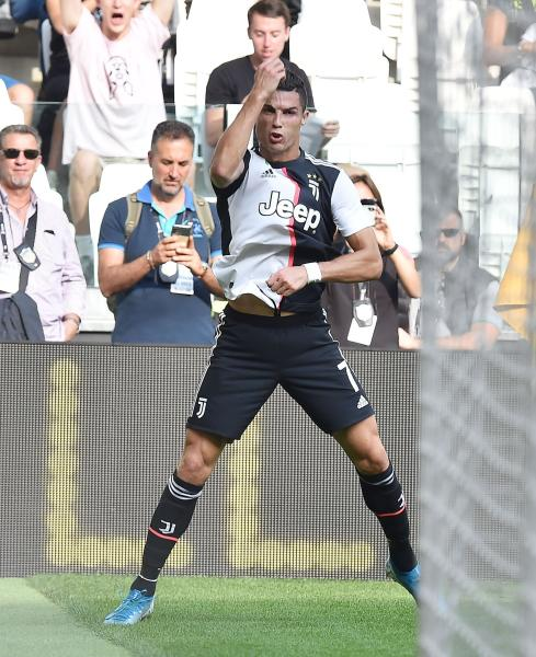 Juventus' Cristiano Ronaldo celebrates after scoring during the Serie A soccer match between Juventus and Spal, at the Allianz Stadium in Turin, Italy, Saturday, Sept. 28, 2019. (Alessandro Di Marco/ANSA via AP)