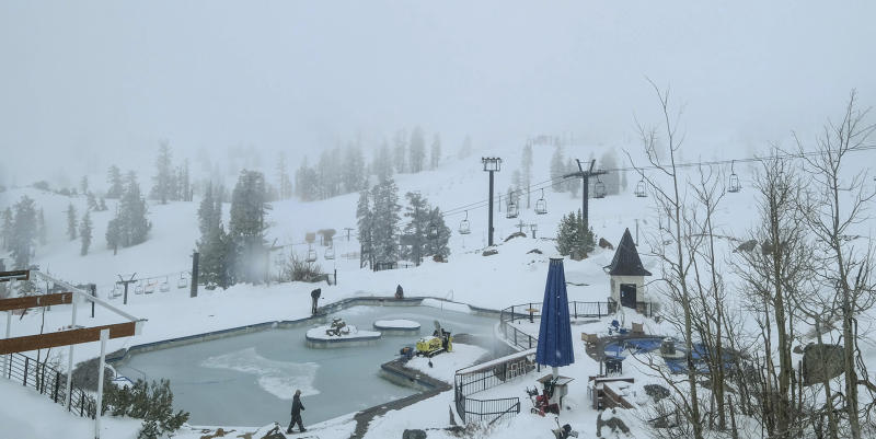 In this webcam image provided by Squaw Valley Alpine Meadows is the snow covered Squaw Valley High Camp Wednesday, May 22, 2019, in Olympic Valley, Calif. Memorial Day may be the unofficial start of summer, but California is heading toward the holiday with rainy, windy and snowy weather. The Squaw Valley resort at Lake Tahoe reports it got 32 inches of snow over the past seven days, boosting its season total to 714 inches. Unsettled weather will continue into next week. (Squaw Valley Alpine Meadows via AP)
