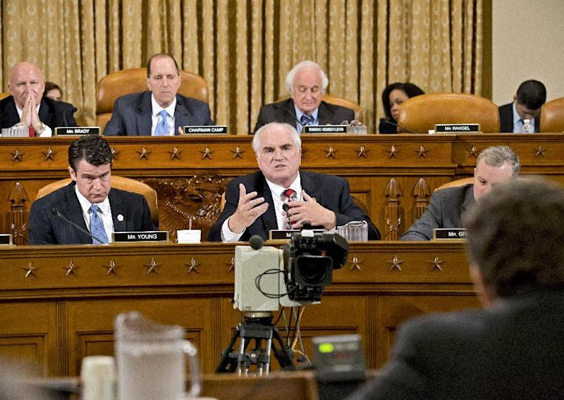 House Ways and Means Committee member Rep. Mike Kelly, R-Pa., center, questions the ousted head of the Internal Revenue Service Steven Miller, lower right, as the Republican-run committee held a hearing on the extra scrutiny the Internal Revenue Service gave Tea Party and other conservative groups that applied for tax-exempt status, Friday, May 17, 2013, on Capitol Hill in Washington. Top row, from left are, Rep. Kevin Brady, R-Texas, Committee Chairman Rep. Dave Camp , R-Mich., and the committee's ranking Democrat Rep. Sander Levin, D-Michigan, D-Mich. Front row, from left are, Rep. Todd Young, R-Ind., Kelly, and Rep. Tim Griffin, R-Ark.  (AP Photo/J. Scott Applewhite)