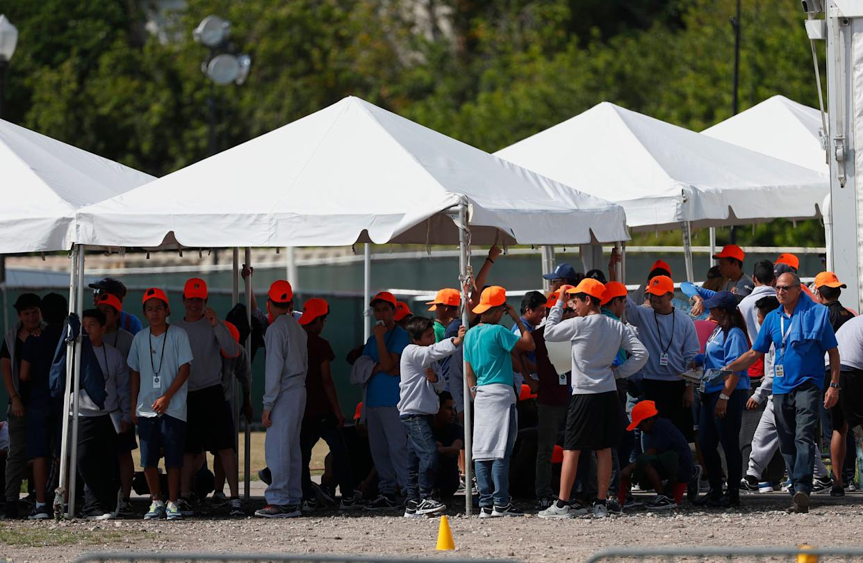 Migrant children stand outside the Homestead Temporary Shelter for Unaccompanied Children in Homestead, Florida, on May 6, 2019. (Photo: Wilfredo Lee/ASSOCIATED PRESS)