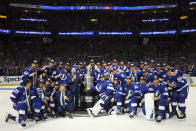 The Tampa Bay Lightning pose with the Stanley Cup after defeating the Montreal Canadiens 1-0 in Game 5 to win the NHL hockey Stanley Cup Finals, Wednesday, July 7, 2021, in Tampa, Fla. (Bruce Bennett/Pool Photo via AP)