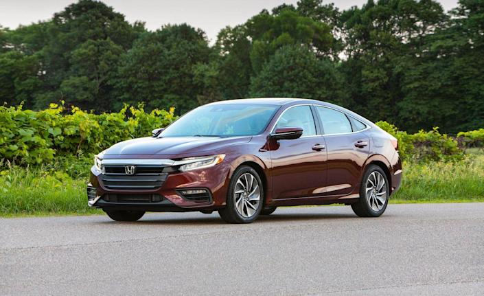 """<p><a href=""""https://www.caranddriver.com/honda/insight"""" rel=""""nofollow noopener"""" target=""""_blank"""" data-ylk=""""slk:The 2019 Honda Insight hybrid"""" class=""""link rapid-noclick-resp"""">The 2019 Honda Insight hybrid</a> is nothing like the previous two Insights Honda has sold to American customers since 1999. The original wore funky tadpole-like styling, had only two seats, and could be purchased with a manual transmission. Later, Honda replaced that Insight with a new one with four doors, a back seat, and only slightly less oddball styling—except it was less efficient than the original Insight and just as unrefined. Today's Insight represents the model's third generation and is essentially a reworked Civic sedan with a hybrid drivetrain. That means it is comfortable, cleanly styled, and feels premium. As a bonus, it delivers up to 52 mpg in combined driving; the fancier Touring trim drops that figure to 48 mpg.<br></p>"""