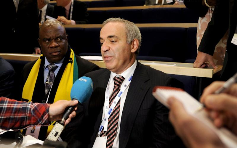Russian former chess champion Garry Kasparov (R) answers journalists' questions after he lost the Fide presidential election in Tromso, Norway - Credit: RUNE STOLTZ BERTINUSSEN