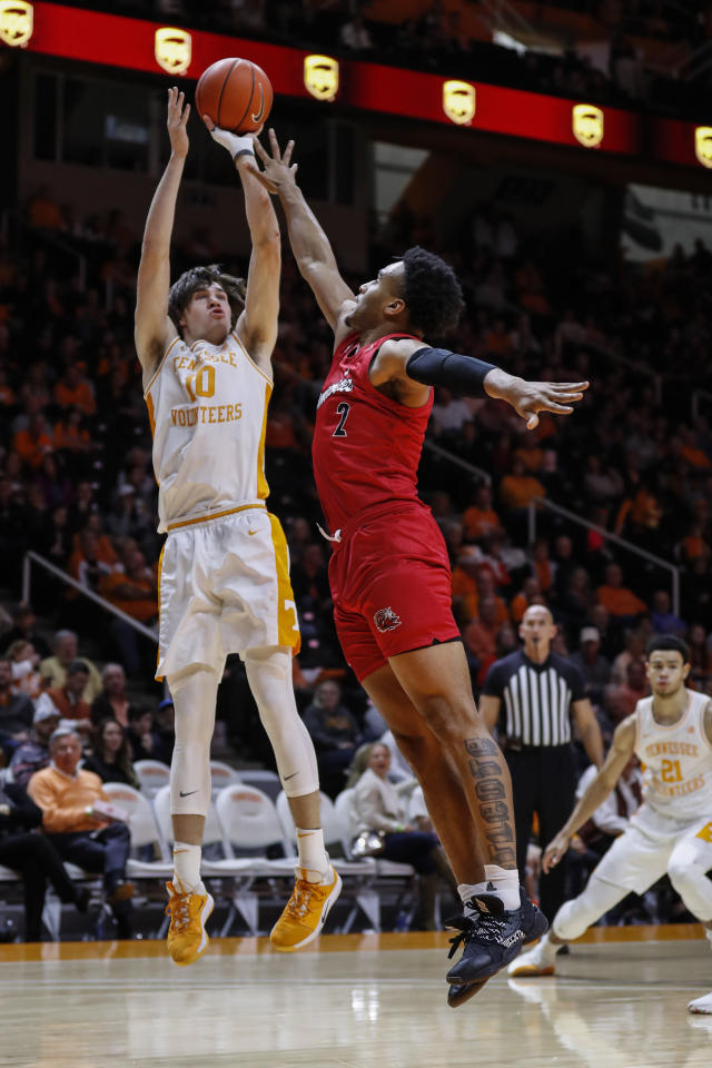 Tennessee forward John Fulkerson (10) shoots over Jacksonville State forward Jacara Cross (2) during the first half of an NCAA college basketball game Saturday, Dec. 21, 2019, in Knoxville, Tenn. (AP Photo/Wade Payne)