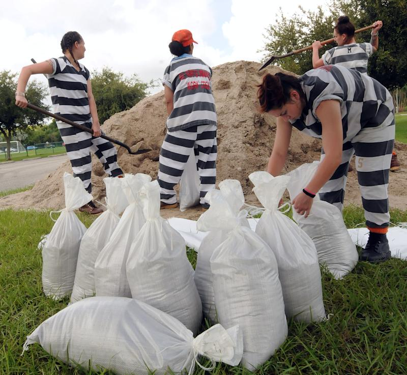 A supervised work crew of female jail prisoners fills sandbags for distribution to local residents in Titusville, Fla., in preparation for the arrival of Hurricane Dorian which is expected to become a Category 4 hurricane before making landfall in Florida on Labor Day. (Photo: Paul Hennessy/SOPA Images via ZUMA Wire)