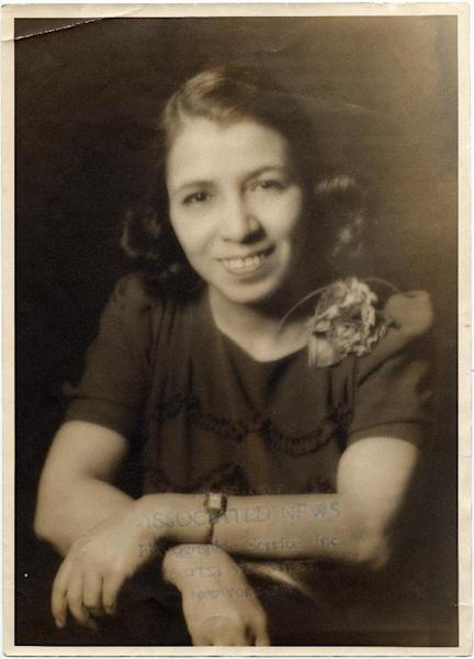"""This undated handout provided by the Smithsonian's National Museum of American History shows Clotilde Arias. A little-known official translation of the U.S. national anthem to be sung in Spanish is now part of the Smithsonian Institution's collection. After World War II, musician and composer Clotilde Arias was commissioned by the U.S. State Department to write a translation that could be sung to the original """"Star-Spangled Banner"""" tune. Curators say it was sent to U.S. embassies in Latin America. (AP Photo/Kay Peterson, Smithsonian's National Museum of American History)"""