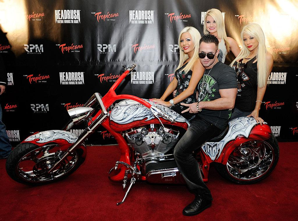 "Ciao, bellas! Mike ""The Situation"" Sorrentino hit the red carpet with not one, not two, but three gorgeous blondes at RPM Nightclub in Las Vegas. Given The Situation's track record with women, we wonder which one he took to the Smush Room at the end of the night. (2/14/2012)"