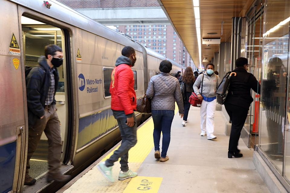 Commuters get off the Metro-North train arriving at 8:39 am in White Plains, which originated at Grand Central Terminal, Oct. 27, 2020.