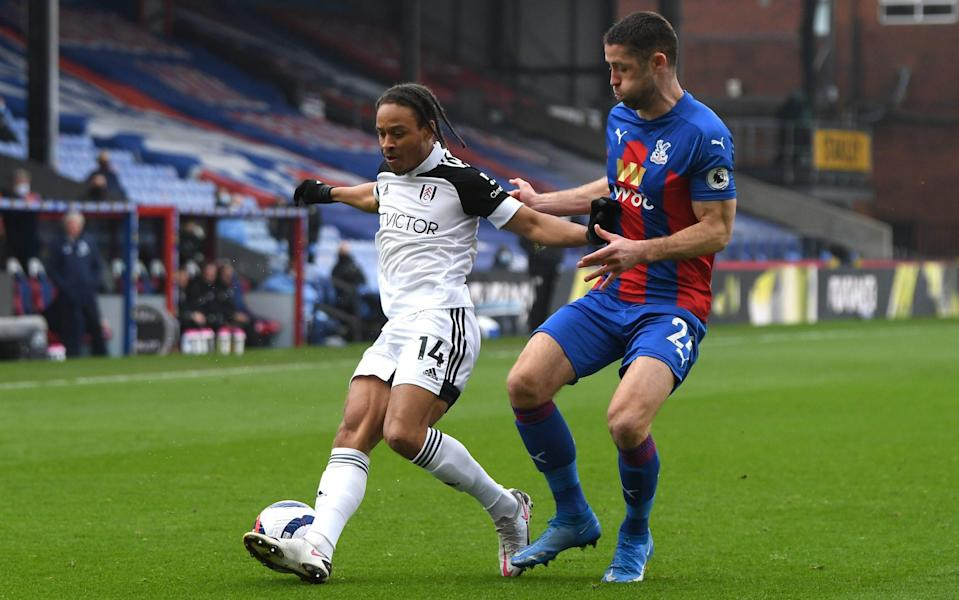 Bobby De Cordova-Reid of Fulham battles for possession with Gary Cahill of Crystal Palace during the Premier League match between Crystal Palace and Fulham at Selhurst Park on February 28, 2021 - Getty Images Europe/Mike Hewitt