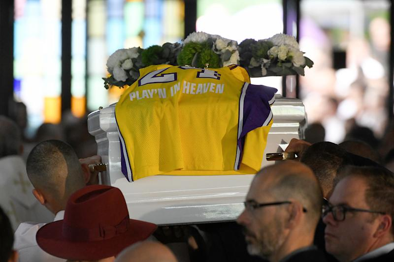 A LA Lakers gurnsey of the late Kobe Bryant, with the words 'Play'N In Heaven' is seen on the coffin of Antony as it leaves the funeral for Antony Abdallah, 13, Angelina Abdallah, 12, and Sienna Abdallah, 8, at Our Lady of Lebanon Co-Cathedral in Sydney, Monday, February 10, 2020. The three siblings were run down and killed by an alleged drunk driver in Oatlands, in Sydney's west. (AAP Image/Bianca De Marchi) NO ARCHIVING