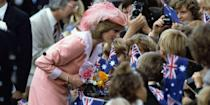 <p>Diana sports a baby pink outfit with a matching feathered hat in Canberra, Australia.</p>