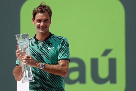 Apr 2, 2017; Key Biscayne, FL, USA; Roger Federer of Switzerland holds the Butch Buchholz trophy after his match against Rafael Nadal of Spain (not pictured) in the men's singles championship of the 2017 Miami Open at Crandon Park Tennis Center. Mandatory Credit: Geoff Burke-USA TODAY Sports