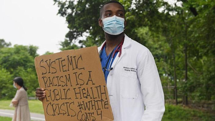 Several hundred doctors, nurses and medical professionals come together to protest against police brutality and the death of George Floyd at Barnes-Jewish Hospital on June 5, 2020 in St Louis, Missouri. (Photo by Michael B. Thomas/Getty Images)