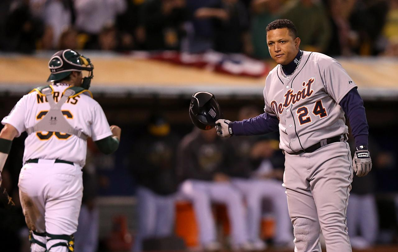 OAKLAND, CA - OCTOBER 09: Miguel Cabrera #24 of the Detroit Tigers reacts after striking out in the sixth inning as Derek Norris #36 of the Oakland Athletics walks back to the dugout during Game Three of the American League Division Series at Oakland-Alameda County Coliseum on October 9, 2012 in Oakland, California.  (Photo by Ezra Shaw/Getty Images)