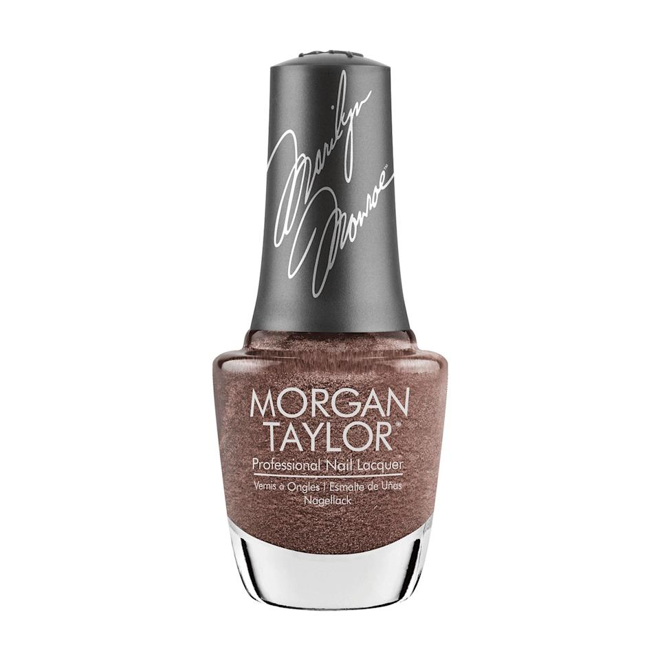 """<p>In the brand's second edition Marilyn Monroe-inspired collection, the Morgan Taylor Nail Lacquer in That's So Monroe is the standout. The color looks like a swirl of brown and champagne mixed with a healthy dose of twinkling shimmer that make it reflect differently from all angles, with glimpses of silver, metallic, and copper, depending on your angle.</p> <p><strong>$10</strong> (<a href=""""https://shop-links.co/1715498416702776586"""" rel=""""nofollow noopener"""" target=""""_blank"""" data-ylk=""""slk:Shop Now"""" class=""""link rapid-noclick-resp"""">Shop Now</a>)</p>"""