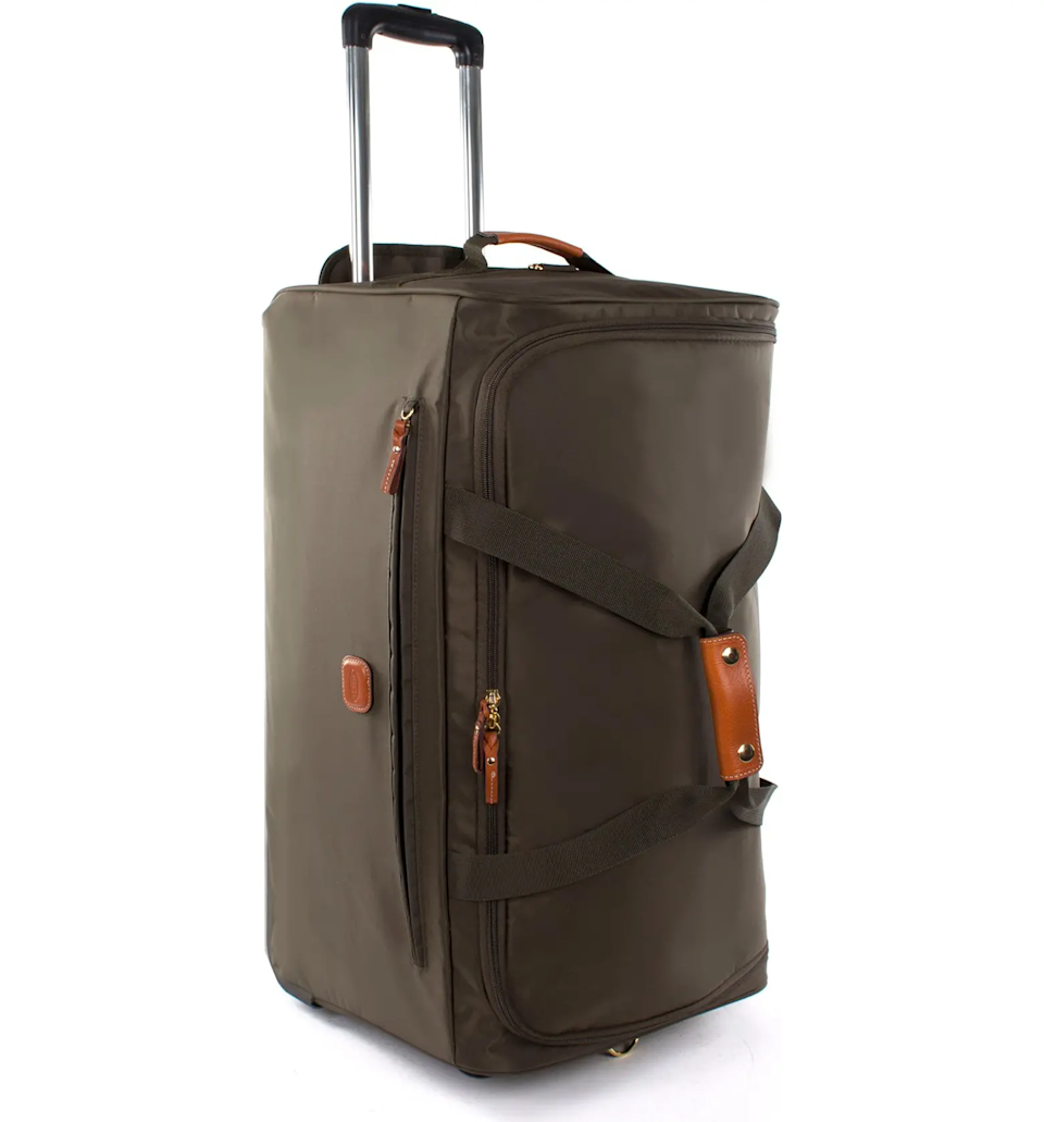 """<strong><h3>Bric's Rolling Duffel</h3></strong><br>Not quite a suitcase, not quite a weekender, this sleek rolling duffel trimmed with leather is the hybrid bag our weekend trips away have been missing — enough space to pack your essentials with room for bringing stuff back.<br><br><em>Shop </em><a href=""""https://www.bedbathandbeyond.com/store/brand/bric-39-s/1273/"""" rel=""""nofollow noopener"""" target=""""_blank"""" data-ylk=""""slk:Bric's"""" class=""""link rapid-noclick-resp""""><strong><em>Bric's</em></strong></a> <br><br><strong>Bric's</strong> X-Bag 21-Inch Rolling Duffle Bag, $, available at <a href=""""https://go.skimresources.com/?id=30283X879131&url=https%3A%2F%2Fwww.bedbathandbeyond.com%2Fstore%2Fproduct%2Fbric-39-s-xtravel-rolling-duffle-bag-collection-in-olive%2F207249"""" rel=""""nofollow noopener"""" target=""""_blank"""" data-ylk=""""slk:Bed Bath & Beyond"""" class=""""link rapid-noclick-resp"""">Bed Bath & Beyond</a>"""