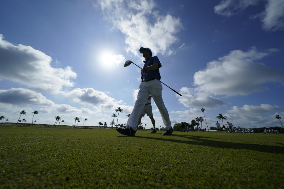 Cole Hammer of the USA team walks down a fairway as he practices for the Walker Cup golf tournament, starting tomorrow, at Seminole Golf Club in Juno Beach, Fla., Friday, May 7, 2021. (AP Photo/Gerald Herbert)