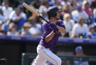 Colorado Rockies' Kyle Freeland follows the flight of his two-run single off Los Angeles Dodgers starting pitcher Max Scherzer in the second inning of a baseball game Thursday, Sept. 23, 2021, in Denver. (AP Photo/David Zalubowski)