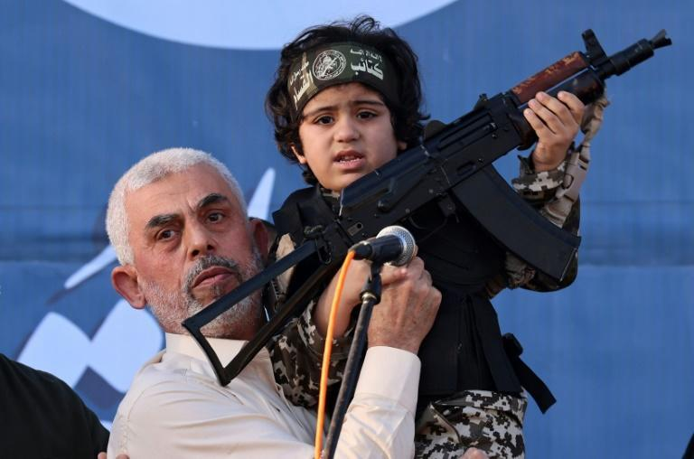 Top Hamas leader in Gaza, Yahya Sinwar, holds the child of an Al-Qassam Brigades fighter, who was killed in the recent fighting with Israel