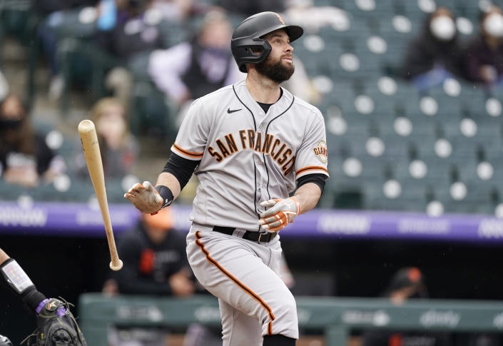 San Francisco Giants' Brandon Belt follows the flight of his three-run home run off Colorado Rockies relief pitcher Jhoulys Chacin in the first inning of game one of a baseball doubleheader Tuesday, May 4, 2021, in Denver. (AP Photo/David Zalubowski)