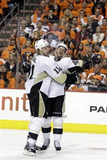 Pittsburgh Penguins' Jordan Staal, left, and Tyler Kennedy celebrate after Staal scored in the second period of Game 4 in a first-round NHL Stanley Cup playoffs hockey series against the Philadelphia Flyers, Wednesday, April 18, 2012, in Philadelphia. (AP Photo/Matt Slocum)