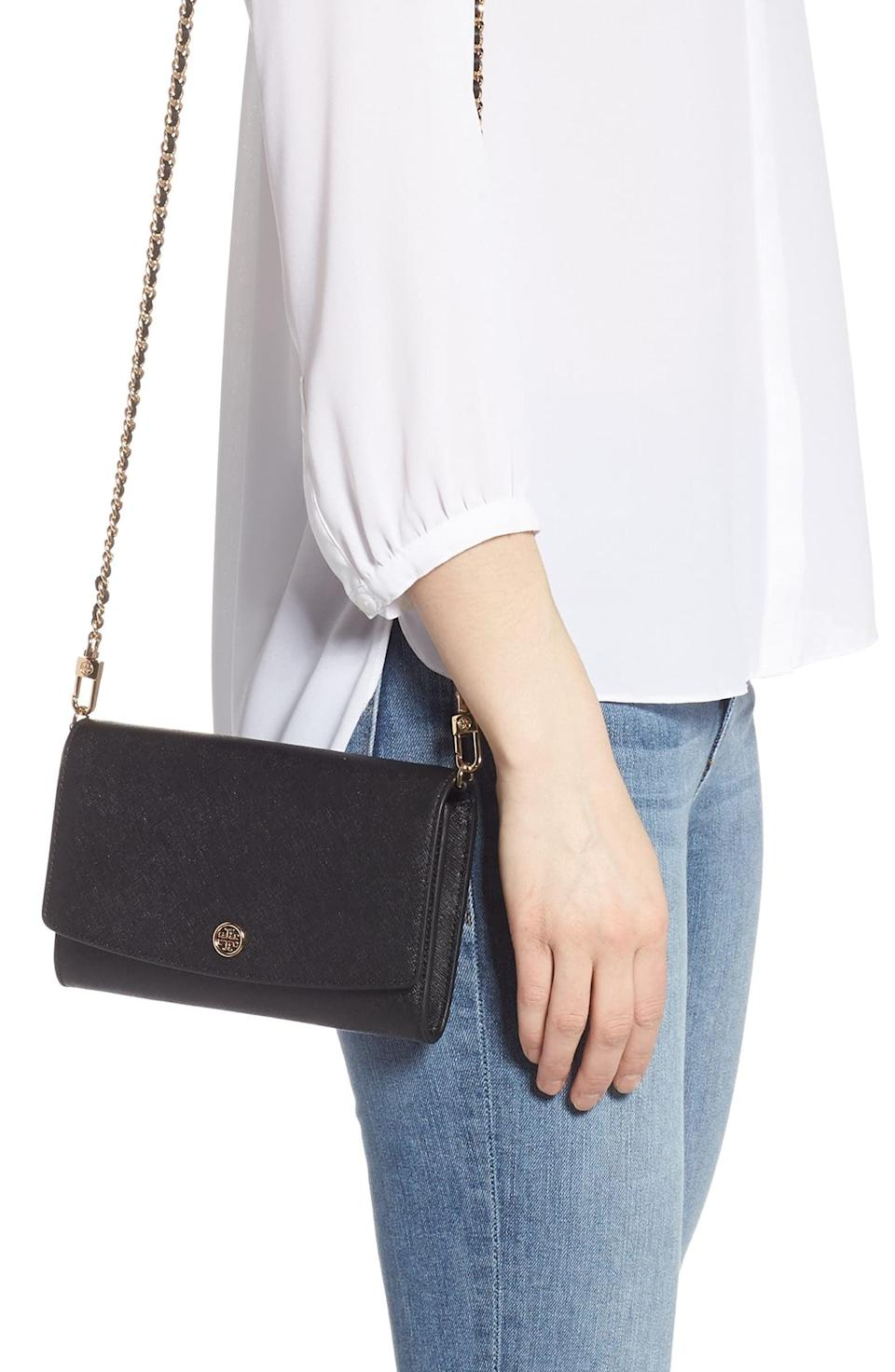 <p>This <span>Tory Burch Robinson Leather Wallet on a Chain</span> ($298) is such a good option because it gives you easy access to your valuables while traveling, and it also doubles as a crossbody for going out.</p>