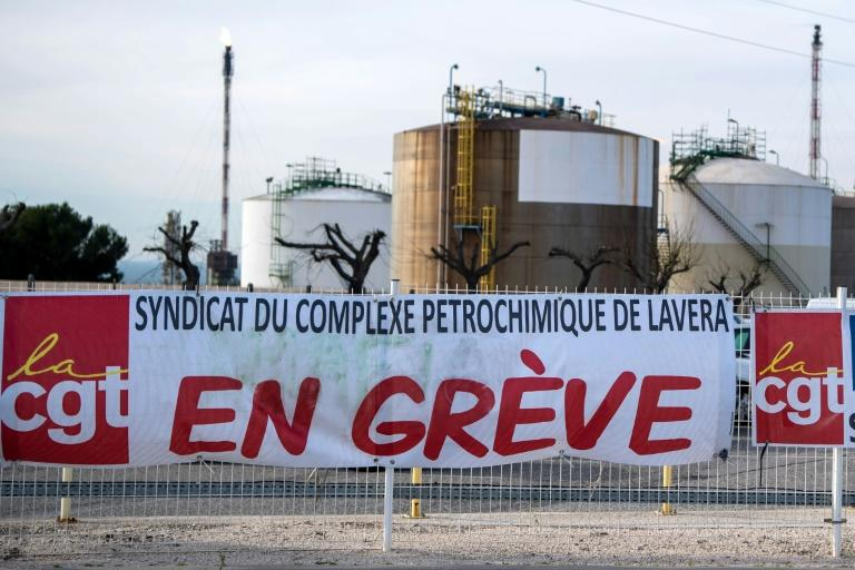 """A CGT union banner reading """"On Strike"""" Tuesday at a blocked oil refinery in Martigues, southern France, as part of protests over a pension reform"""