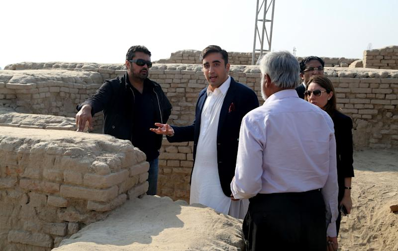In this Thursday, Jan. 30, 2014 photo provided by Bilawal House, Bilawal Bhutto Zardari, second from left, son of Pakistan's assassinated Prime Minister Benazir Bhutto visits the site of Sindh Cultural Festival in ruins of Mohenjodaro in Pakistan. A plan by Bilawal to hold a cultural festival at an ancient site in southern Pakistan has sparked controversy, with several leading archaeologists saying Friday it could damage the ruins. (AP Photo/Bilawal House)
