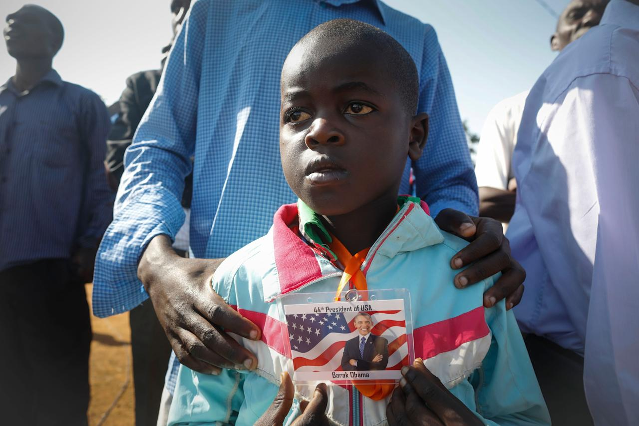 <p>Nine-year-old Barack Obama Omondi, who was named after former US president Barack Obama when he was first elected as President in 2008, looks on as he waits for Obama's arrival with his father Daniel Omondi prior to an opening ceremony of the Sauti Kuu Sports, Vocational and Training Centre in his ancestral home Kogelo, some 400km west of the capital Nairobi, Kenya on July 16, 2018. Barack Obama visited his ancestral home in western Kenya to attend the opening ceremony of the centrer founded by his half-sister Auma Obama, after having met with Kenyan President Uhuru Kenyatta and opposition politician Raila Odinga in Nairobi the previous day. After Kenya, Obama is scheduled to travel to South Africa where he will deliver the annual Nelson Mandela lecture in Johannesuburg. (Photo: Dai Kurokawa/EPA-EFE/REX/Shutterstock) </p>