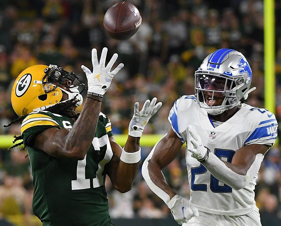 Packers wide receiver Davante Adams catches a pass against Lions cornerback Ifeatu Melifonwu during the second half of the Lions' 35-17 loss on Monday, Sept. 20, 2021, in Green Bay, Wisconsin.