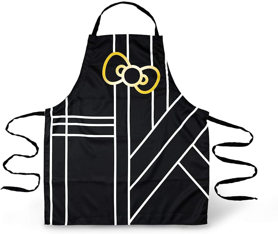 <p>If you're not into pink, the <span>Seven20 Hello Kitty Glam Pinache Black &amp; Gold Apron</span> ($25) is a must-have. It's so glam and stylish, it's perfect for the master chef in your life!</p>