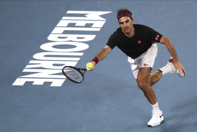 Switzerland's Roger Federer makes a forehand return to Australia's John Millman during their third round singles match at the Australian Open tennis championship in Melbourne, Australia, Friday, Jan. 24, 2020. (AP Photo/Dita Alangkara)