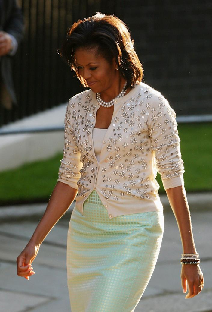 michelle obama wearing a white and green ensemble at the g-20 summit in 2009