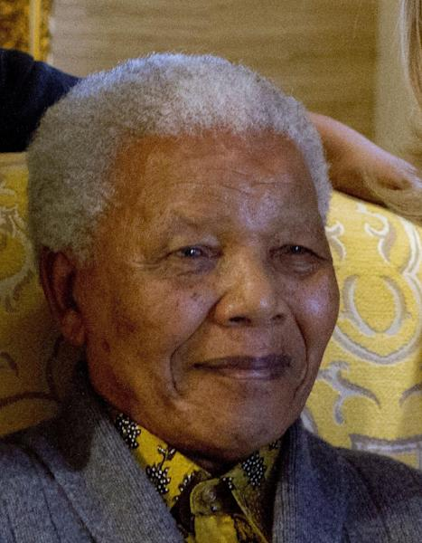 FILE - This photo taken Monday Aug. 6, 2012 shows former South African president, Nelson Mandela, when he met with US Secretary of State Hillary Rodham Clinton, unseen, at his home in Qunu, South Africa. Mandela on Friday Dec 14 2012 entered the seventh day of a hospital stay for a lung infection as questions grow about where he is receiving treatment. The 94-year-old patriarch of South Africa's democracy has been hospitalized since Saturday, first undergoing tests and later being diagnosed with the ailment. (AP Photo/Jacquelyn Martin, Pool, File)