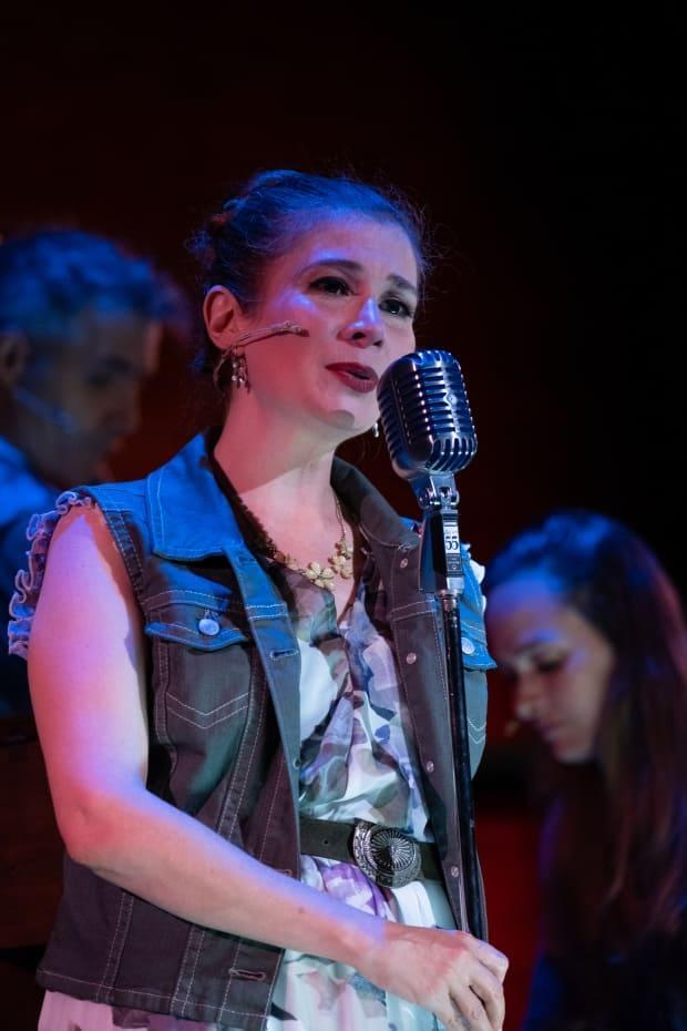 Lindsay Kyte performs one of Rita MacNeil's songs during her show Dear Rita, which plays at the Confederation Centre of the Arts until Aug. 6. (Confederation Centre of the Arts - image credit)
