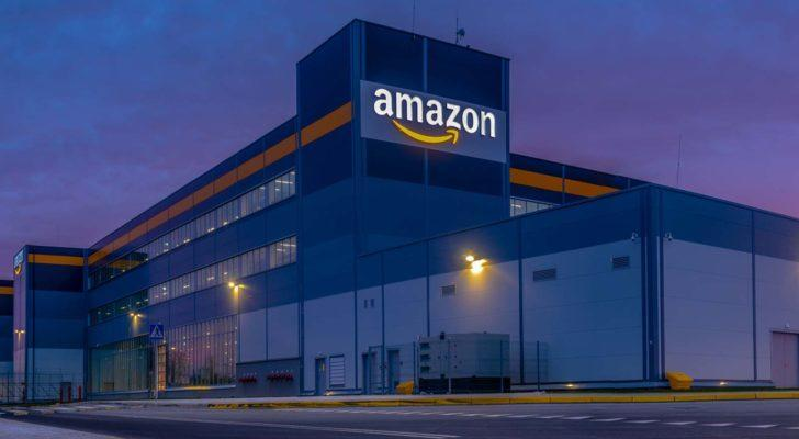 Amazon (AMZN) building at night time with logo light up on building