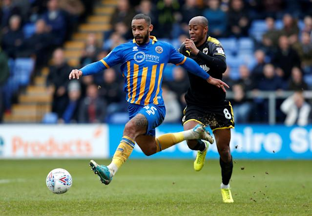 "Soccer Football - League One - Shrewsbury Town vs AFC Wimbledon - Montgomery Waters Meadow, Shrewsbury, Britain - March 24, 2018 Shrewsbury Town's Stefan Payne in action with AFC Wimbledon's Jimmy Abdou which led to appeals for a penalty Action Images/Ed Sykes EDITORIAL USE ONLY. No use with unauthorized audio, video, data, fixture lists, club/league logos or ""live"" services. Online in-match use limited to 75 images, no video emulation. No use in betting, games or single club/league/player publications. Please contact your account representative for further details."