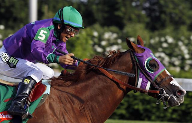 Victor Espinoza rides California Chrome to a victory during the 140th running of the Kentucky Derby horse race at Churchill Downs Saturday, May 3, 2014, in Louisville, Ky. (AP Photo/Garry Jones)